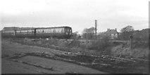 NY6366 : Train passing milecastle at Gilsland, 1969 by Derek Harper