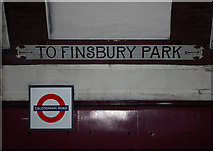 TQ3084 : Direction sign, Caledonian Road Underground Station by Jim Osley