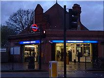 TQ2473 : Southfields Underground Station at dusk by Robin Sones