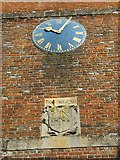 SU6676 : Clock and coat of arms by Bill Nicholls