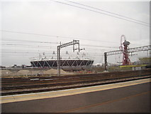 TQ3783 : View of the Olympic Stadium and Arcelo-Mittal Orbit sculpture from a DLR train #2 by Robert Lamb