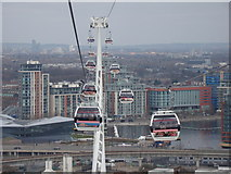 TQ3980 : View of other cable cars and the Royal Docks from the Emirates Air Line by Robert Lamb