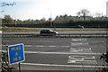 SP1272 : M42 junction 3a west: road markings by Robin Stott