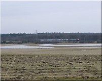 NZ2294 : Flooded fields by Russel Wills