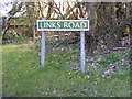 TG5201 : Links Road sign by Adrian Cable