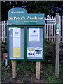 TM4469 : St.Peter's Church Notice Board & footpath sign by Adrian Cable
