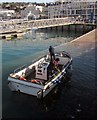 SX9163 : Cleaning up the harbour, Torquay by Derek Harper
