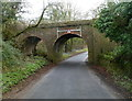 SU0098 : North side of a disused railway bridge north of Ewen by Jaggery