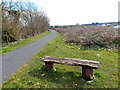 SN3907 : Wooden bench alongside the Wales Coast Path, Kidwelly by Jaggery