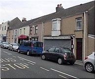 SS8983 : Cars, shops and houses, Bridgend Road, Aberfenkig by Jaggery
