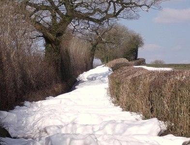 SK1042 : Snowdrifts on Broomfield Lane by Ian Calderwood