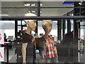 NY3703 : Shop window near Waterhead by Ian Cunliffe
