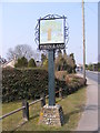 TG2701 : Poringland Village sign by Adrian Cable