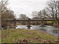 SS5826 : A footbridge on the River Taw at Chapelton as seen from downstream by Roger A Smith