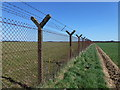 TF8631 : Sculthorpe Airfield security fencing near Tatterford Longrow by Richard Humphrey