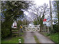 TM4072 : Level Crossing on the entrance to South Manor Farm by Adrian Cable