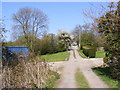 TM4071 : Entrance to South Manor Farm & footpath by Adrian Cable