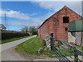 SJ2933 : Roadside buildings at Daywall Farm by John Haynes