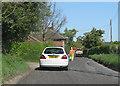 TG0539 : Rolling roadworks on Blakeney Road by Pauline E