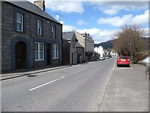 J0115 : View north along Main Street, Forkhill by Eric Jones