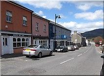 J0115 : Shops on Main Street, Forkhill by Eric Jones