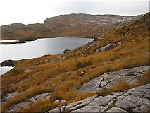 G9889 : Granite slabs above Lough Belshade by Richard Webb