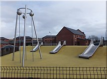 NS3977 : Play area in new housing estate by Barbara Carr