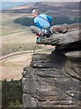 SK2483 : Stanage Edge rock climber above Stanage Plantation by Neil Theasby