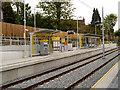 SJ8491 : Didsbury Village Tram Stop by David Dixon