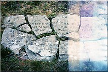 NJ5305 : Fragments of a plaque on Craiglich by Stanley Howe
