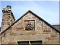 NU1328 : Coat of arms on terrace, Warenford by Graham Robson