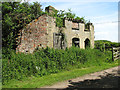 TM4094 : Remains of a gate house by the entrance to Lodge Farm by Evelyn Simak
