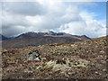NH1639 : Lone boulder near moorland col by Trevor Littlewood