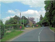 SU1012 : B3078 passes The Church of St James by Stuart Logan