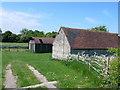SP1054 : Old Farm Buildings by Nigel Mykura