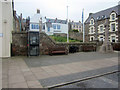 NT9464 : Public phone box and war memorial, Eyemouth by Graham Robson