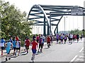 NZ2063 : Competitors in the 2013 Blaydon Races approach Scotswood Bridge by Andrew Curtis