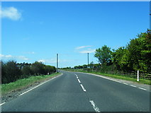 NS6439 : A71 looking west at Burnbank by Colin Pyle
