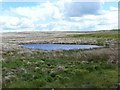NY7359 : Pond on Limestones Fell by Oliver Dixon