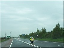 J1977 : PSNI motorcyclists on the A26 south of the Belfast International Airport by Eric Jones