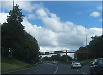 NZ4819 : Footbridge over the A66 as it nears the Newport Interchange by peter robinson