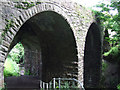 NS4064 : Old railway bridges over Locher Water by Thomas Nugent
