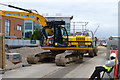 SK5438 : A digger at work on Science Road by David Lally