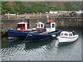 NT9560 : Four little boats in a row, Burnmouth Harbour by Graham Robson