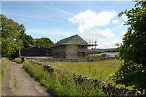 SK1583 : New barn, farm building, with caravan by Peter Barr