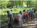 SP9713 : Crowds of Visitors at Clickmere Pond, Ashridge, Easter 2011 by Chris Reynolds