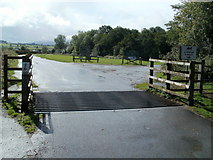 SO1327 : Grid across the entrance to Llangorse Common by Jaggery