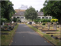 TQ2673 : Earlsfield:  A corner of Wandsworth Cemetery with Earlsfield Library behind by Dr Neil Clifton