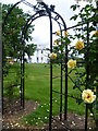 TQ3170 : View through the rose arbour of Norwood Grove by Marathon