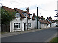 SE8873 : White-painted stone cottages along the street by Pauline E